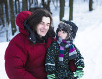 Young happy father with his son little cute boy outside in winter park, lifestyle people concept. Close up Royalty Free Stock Image