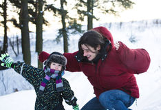 Young happy father with his son little cute boy outside in winter park, lifestyle people concept. Close up Royalty Free Stock Photography