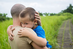 Young happy father holding up in his arms little son Stock Photography