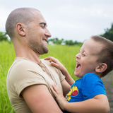 Young happy father holding up in his arms little son Royalty Free Stock Image