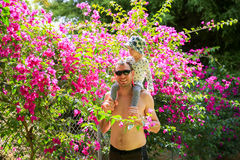 Young happy Father with little daughter on his shoulders royalty free stock image