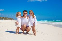Young happy father and little daughters having fun Stock Photography