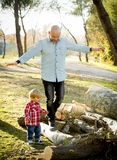 Young happy father playing with excited little cute son walking Stock Photography