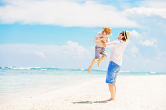 Young happy father playing with his little son Stock Photography