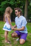 Young happy father talking with cute daughter in Stock Photos