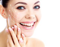 Young happy female with clean fresh skin Stock Photography