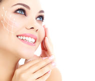Young happy female with clean fresh skin. White background royalty free stock images