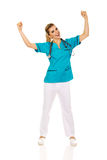 Young happy female doctor with hands up Stock Image