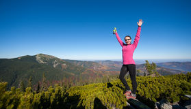 Young happy female hiker at the mountain top Stock Photos