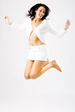Young happy female jumping Stock Image