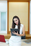 Young happy female makes some notes in notepad.  Royalty Free Stock Image