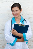 Young happy female medic royalty free stock images
