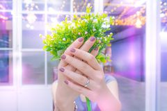 Young happy female show silver wedding ring and white rose bouqu stock image
