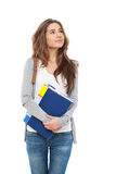 Young happy female student looking looking up isolated. Royalty Free Stock Photos