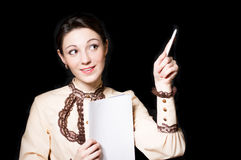 Young happy female teacher or business woman showing on board Royalty Free Stock Photos