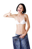 Young happy woman with big pants Stock Image