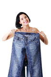 Young happy fit woman with big pants Royalty Free Stock Image