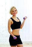 Young happy fit woman with dumbbells Royalty Free Stock Images