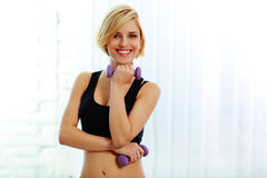 Young happy fit woman with dumbbells Royalty Free Stock Photography