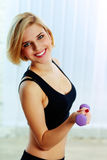 Young happy fit woman holding dumbbells Royalty Free Stock Photography