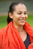 Young happy fit woman with towel outdoor Stock Photos
