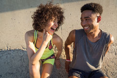 Young happy fitness couple in sportswear talking Stock Photos