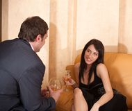 Young happy flirting couple in cafe Stock Photo
