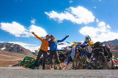 Young happy friends cyclists standing on road in royalty free stock image