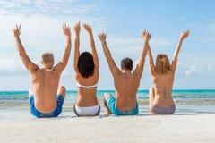 Young happy friends havin fun on the beach Stock Photos