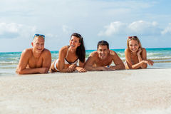 Young happy friends havin fun on the beach royalty free stock photography