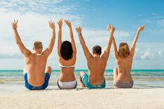 Young happy friends havin fun on the beach Stock Images