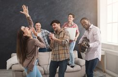 Young happy friends having party at home Royalty Free Stock Photography