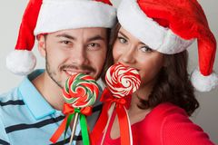 Christmas couple with lollipops Stock Photo
