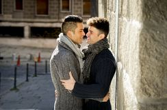 Young happy gay men couple cuddling on street free homosexual love concept Royalty Free Stock Images