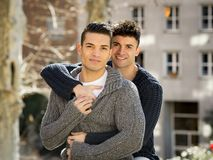 Young happy gay men couple cuddling on street free homosexual love concept Stock Image