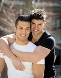 Young happy gay men couple cuddling on street free homosexual love concept Stock Photos