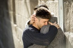 Young happy gay men couple hugging on street free homosexual love concept Stock Photography