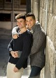 Young happy gay men couple on street free homosexual love concept Stock Photos