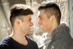 Young happy gay men couple on street free homosexual love concept Stock Photo