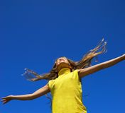 Young happy girl. Over blue sky Royalty Free Stock Images