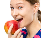 Young happy girl with apple Royalty Free Stock Images