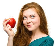 Young happy girl with apple Stock Photos