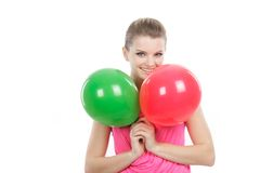 Young happy girl with balloons over white Stock Photography