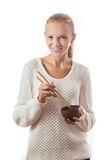 A young happy girl with bowl and chopsticks Stock Photo