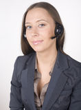 Young happy girl call operator in headphones close Royalty Free Stock Photos