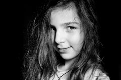 Young happy girl. Young happy child who looks at us with her long hair royalty free stock image