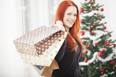 Young happy girl with christmas bags Royalty Free Stock Photos