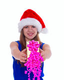Young happy girl in Christmas hat and holding gift Stock Photography