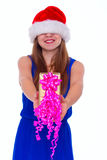 Young happy girl in Christmas hat and holding gift Royalty Free Stock Photos
