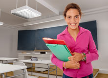Young happy girl in a classroom Stock Photos